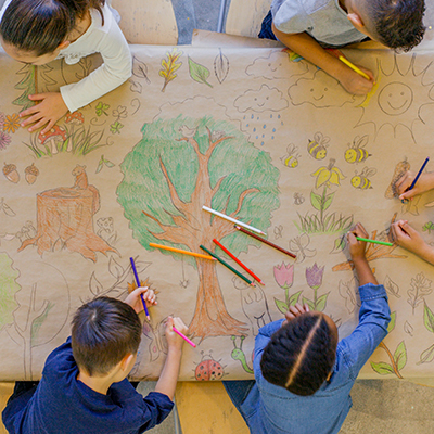 children coloring a nature picture