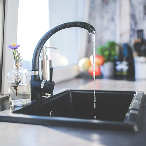 kitchen faucet with water running