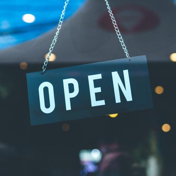 "Sign in store window that says ""Open"""