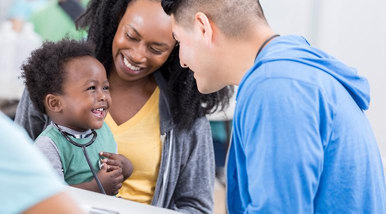 Smiling young family visiting a medical office