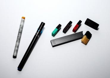 Types of e-cigarettes laying on a table with filters
