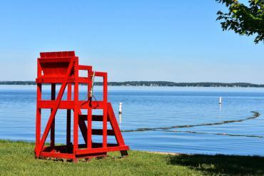 Red lifeguard chair overlooking beach