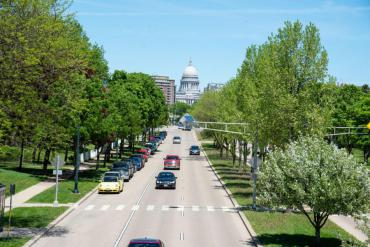 Cars driving on Madison street with Capitol building