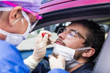 A person in their car being tested for COVID-19